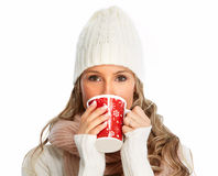 Young woman drinking hot tea. Stock Photography