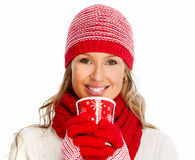 Young woman drinking hot tea. Royalty Free Stock Images