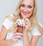 Young woman drinking ice coffee Stock Photography