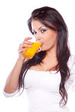 Young woman drinking juice royalty free stock photos