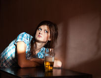 Young woman drinking lager Stock Photo
