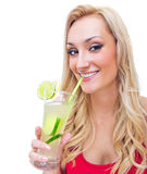 Young woman drinking lemonade Stock Images