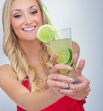 Young woman drinking lemonade Stock Photo