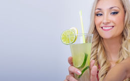 Young woman drinking lemonade Stock Photos