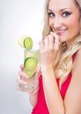 Young woman drinking lemonade Stock Photo