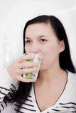 Young woman drinking lemonade Royalty Free Stock Images