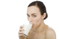 Young woman drinking milk Royalty Free Stock Images