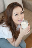 Young Woman Drinking Milk Royalty Free Stock Photos