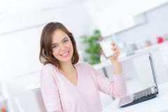 Young woman drinking milk at home. Young woman is drinking milk at home Stock Photo