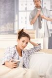 Young woman drinking morning tea in bed Royalty Free Stock Images