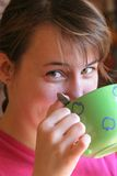 Young woman drinking from mug. Young woman drinking from a mug Royalty Free Stock Photo