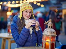 Young woman drinking mulled wine on Christmas Market Royalty Free Stock Photo