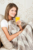 Young woman drinking orange juice in the Stock Images