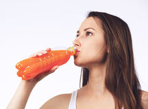 Young woman drinking orange juice Royalty Free Stock Photo