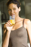 Young woman drinking orange juice, close-up Royalty Free Stock Image