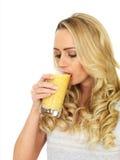 Young Woman Drinking Orange Juice Royalty Free Stock Image