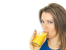 Young Woman Drinking Orange Juice Stock Photos