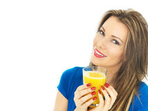 Young Woman Drinking Orange Juice Stock Photography