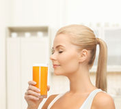 Young woman drinking orange juice Royalty Free Stock Photos