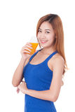 Young woman drinking orange juice. Portrait of young woman drinking orange juice Stock Photos