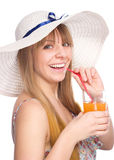 Young woman is drinking orange juice Stock Photography