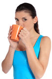 Young woman drinking out of a mug Stock Photo