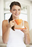 Young Woman Drinking Out Of An Orange Cup Royalty Free Stock Photography