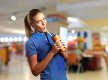 Young woman drinking Royalty Free Stock Images