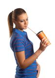 Young woman drinking from a paper cup Stock Image