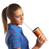 Young woman drinking from a paper cup Royalty Free Stock Image