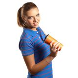 Young woman drinking from a paper cup Royalty Free Stock Photos