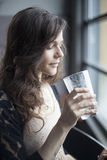 Young Woman Drinking a Pint Glass of Ice Water Royalty Free Stock Photos