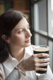 Young Woman Drinking a Pint of Stout Royalty Free Stock Photo