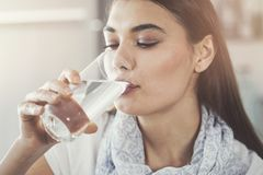 Young woman drinking pure glass of water. Young woman drinking  pure glass of water Stock Images
