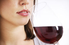 Young woman drinking red wine. On white background Stock Images