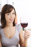 Young woman drinking red wine. On white background Stock Photos