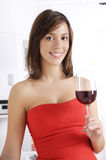 Young woman drinking red wine. On white background Royalty Free Stock Photo