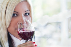 Young woman drinking red wine Royalty Free Stock Photos