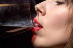 Young woman drinking red wine from a glass Stock Photos