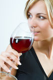 Young woman drinking red wine Royalty Free Stock Images