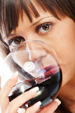 Young woman drinking red wine Royalty Free Stock Photography