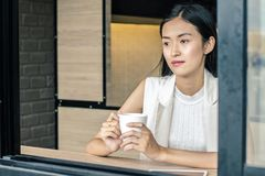 Young woman drinking relaxing coffee. In coffee shop Royalty Free Stock Photo