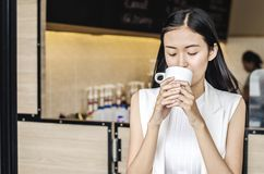 Young woman drinking relaxing coffee. In coffee shop Royalty Free Stock Photography