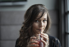 Young Woman Drinking a Shirley Temple Royalty Free Stock Photography