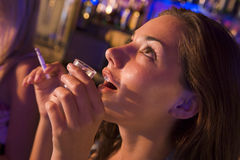 Young woman drinking shots and smoking Royalty Free Stock Image