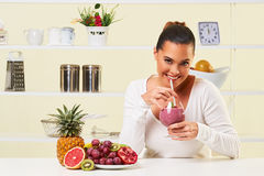 Young woman drinking a smoothie fruit drink health delicious sip weight loss diet Stock Images