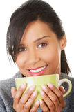 Young woman drinking something from big mug Stock Photos