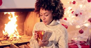 Young woman drinking spicy lemon tea stock video footage