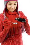 Young woman drinking syrup Stock Photo