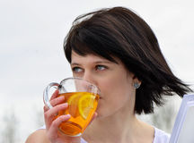 Young woman drinking tea. Outdoors Stock Photo